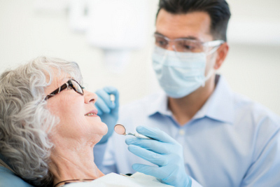 Older woman smiling at Implant and Periodontal Wellness Center of Arizona in Phoenix, AZ