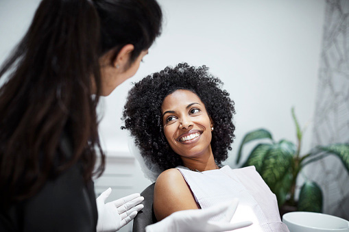 Beautiful Black woman smiling at Implant and Periodontal Wellness Center of Arizona in Phoenix, AZ