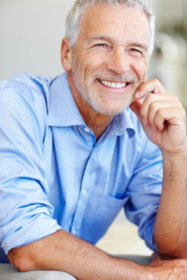 a smiling patient with all-on-4 treatment from Implant and Periodontal Wellness Center of Arizona