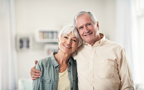 old couple smiling at Implant and Periodontal Wellness Center of Arizona